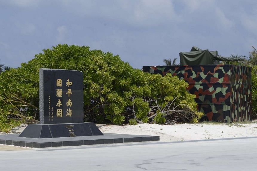 """A memorial plaque signed by then-Taiwan President Ma Ying-jeou, is engraved with the words, """"Peace in the South China Sea and our national territory secure forever"""", in Itu Aba, on March 23, 2016."""