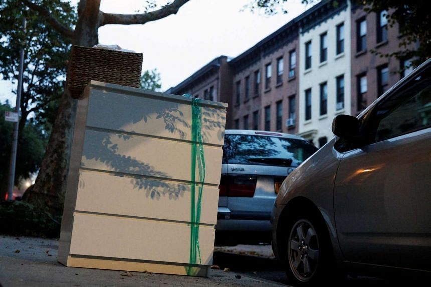 An Ikea MALM dresser is placed by the road, following the recall of almost 36 million chests and dressers in the US and Canada, seen in New York City, June 28.