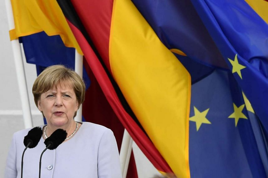 German Chancellor Angela Merkel delivers her speech to foreign diplomatic representatives at the annual meeting at Meseberg Palace, on July 11, 2016.