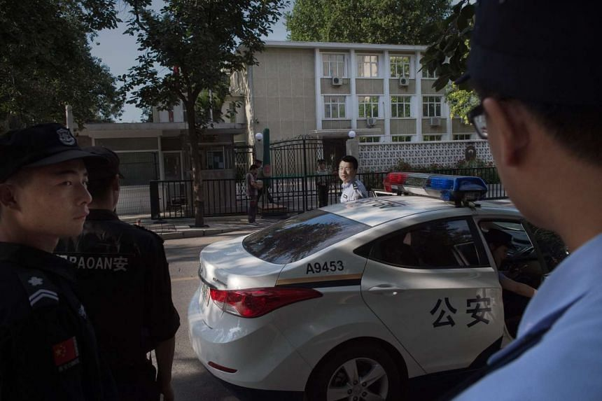 Chinese police officers keep watch outside the Philippines embassy in Beijing, on July 12, 2016.