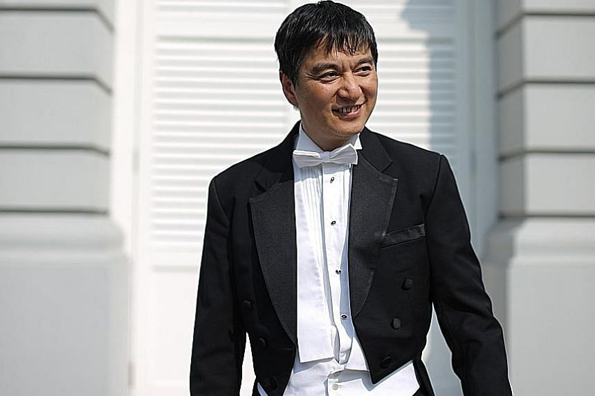 The China-born Shui Lan (above) has helped groom young conductors.