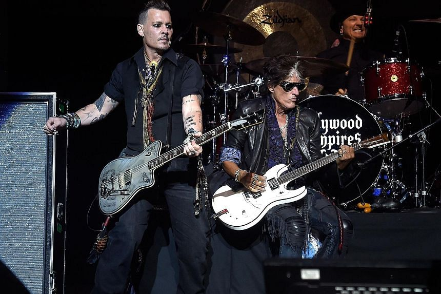 Johnny Depp (left) and Joe Perry of Hollywood Vampires performing at the Ford Amphitheater at Coney Island Boardwalk in New York on Sunday.
