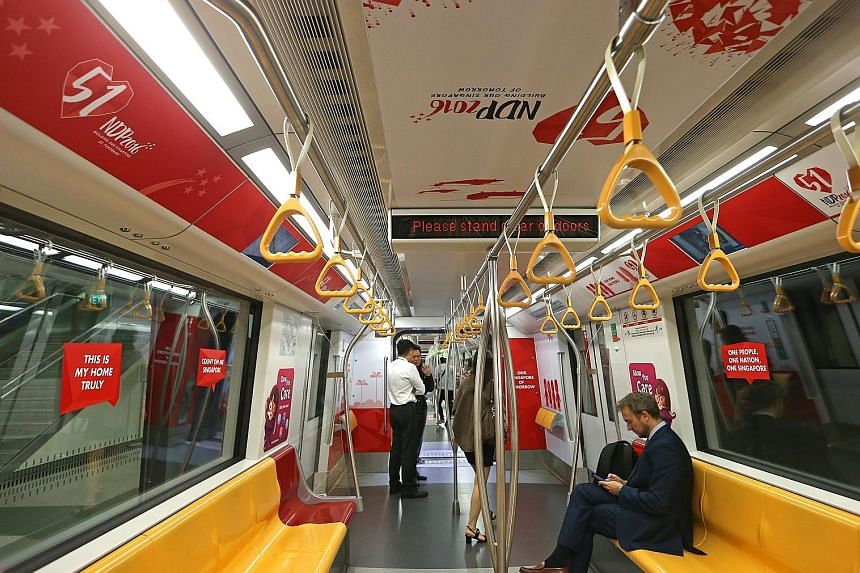 Four trains awash in red and white will be running on different MRT lines until mid-August. Two of them began service yesterday.