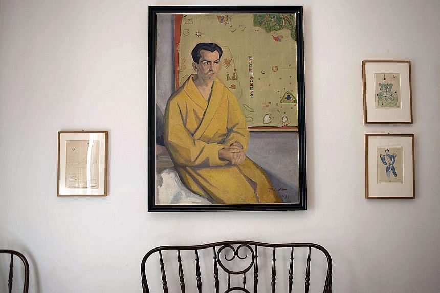 A portrait (above) of poet and playwright Federico Garcia Lorca.
