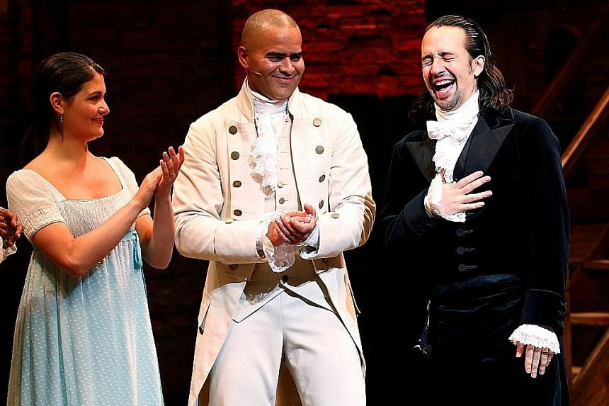 Actor Lin-Manuel Miranda (above right) at his last performance, with fellow cast members Phillipa Soo and Christopher Jackson.