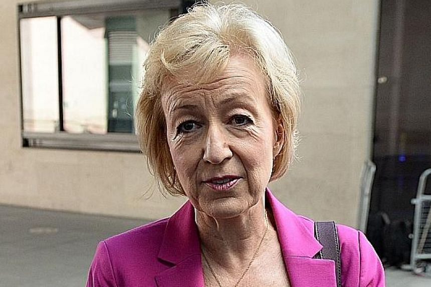 "Mrs May, set to become Britain's second female prime minister, at Birmingham's Institute of Engineering and Technology yesterday. In a speech, she called for ""a country that works for everyone, not just the privileged few"". Mrs Leadsom said a nine-we"