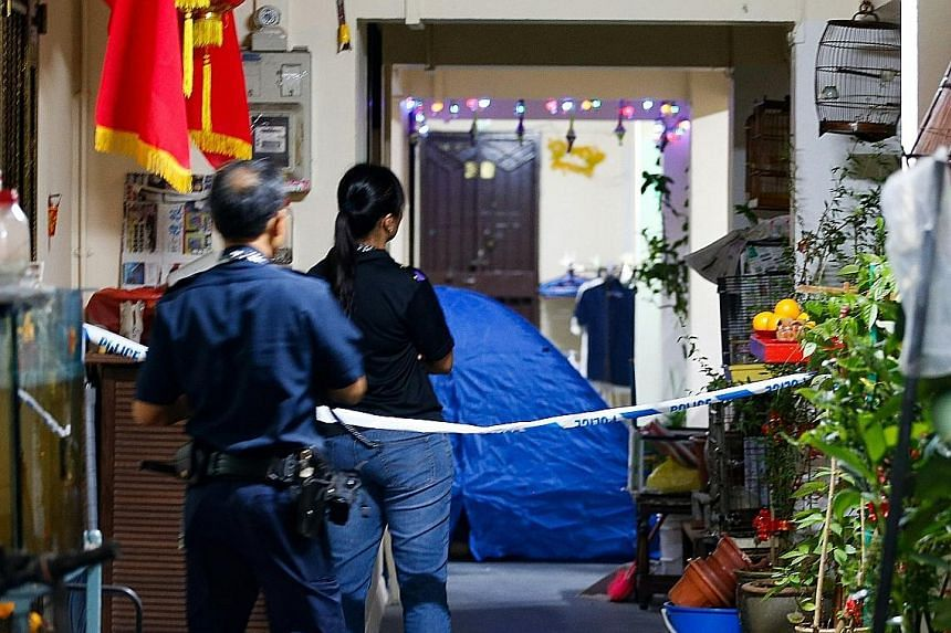 Police at Block 279 in Yishun Street 22 last Saturday, where a 26-year-old man was found lying motionless and pronounced dead.