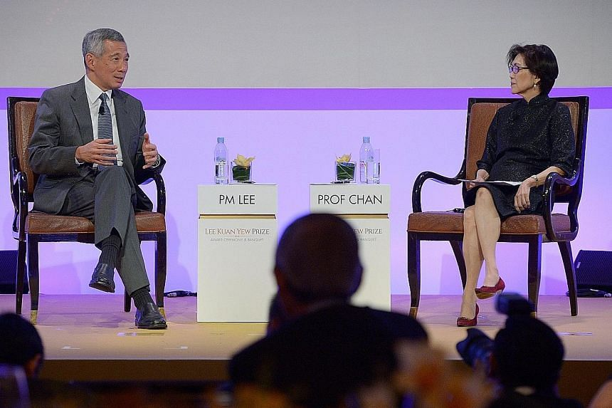 PM Lee and Ambassador-at-Large Chan Heng Chee at last night's dialogue. Prof Chan, chairman of the Lee Kuan Yew Centre for Innovative Cities at the Singapore University of Technology and Design, was the moderator.