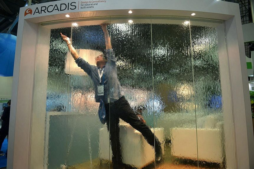 The Arcadis design and consultancy firm's exhibit at the City Solutions Singapore exhibition at the Sands Expo and Convention Centre yesterday. The exhibition is part of the ongoing World Cities Summit, Singapore International Water Week and CleanEnv