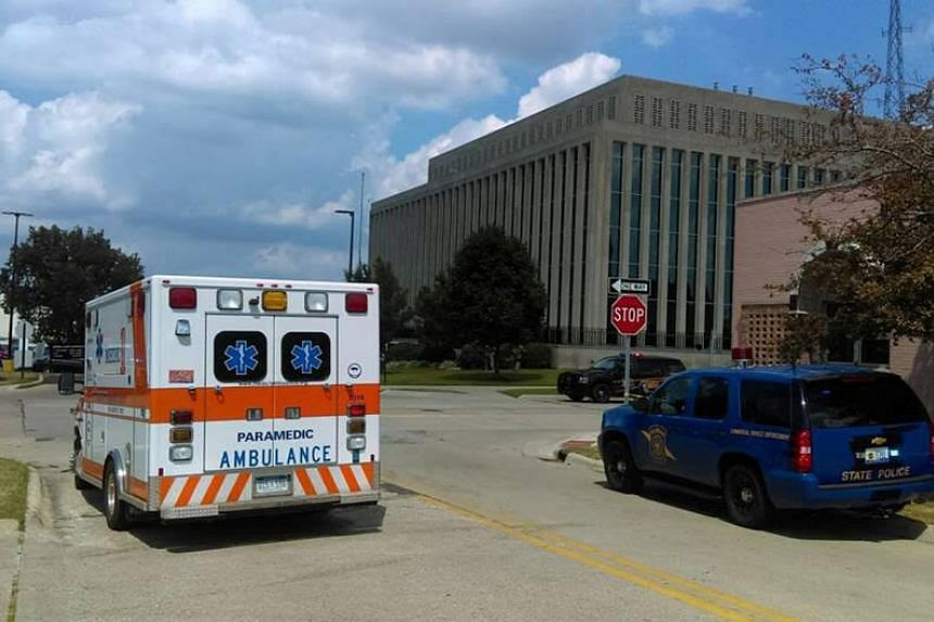 An ambulance is seen outside the Berrien County Courthouse in St. Joseph, Michigan, where an inmate opened fire killing two bailiffs before being shot dead.