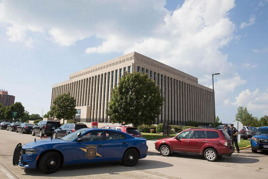 Berrien County Sheriff's Deputies and Michigan State Police stand guard at Berrien County Courthouse.