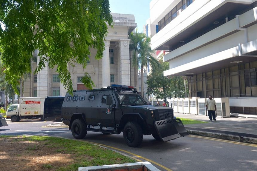 The first of the 3 Armoured vehicles to arrive at the State Courts carrying Rahman Mizanur, 31; Miah Rubel, 26; Md Jabath Kysar Haje Norul Islam Sowdagar, 31; and Sohel Hawlader Ismail Hawlader, 29.