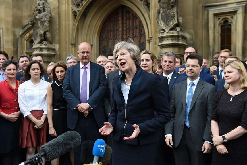 British Prime-Minister-in-waiting Theresa May delivers a statement outside parliament in London on July 11. May is expected to become Britain's second female prime minister on Wednesday, July 13.
