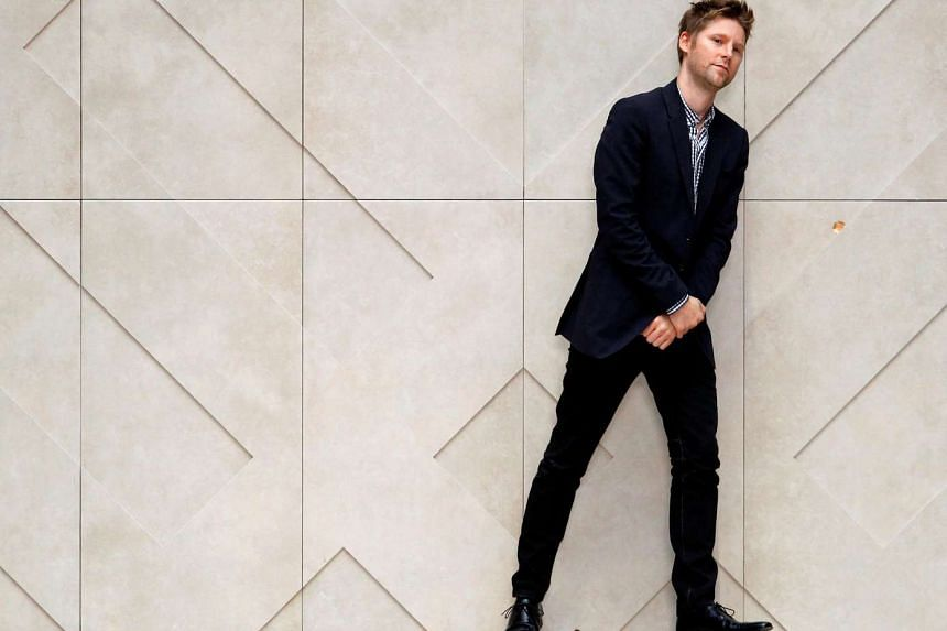 Chief creative officer of Burberry Christopher Bailey walks on the catwalk following the presentation of the Burberry Prorsum 2012 Spring/Summer collection during London Fashion Week, Britain, in 2011.