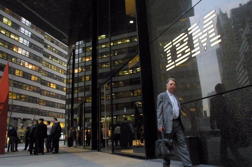 A pedestrian walks past the IBM building in midtown Manhattan.