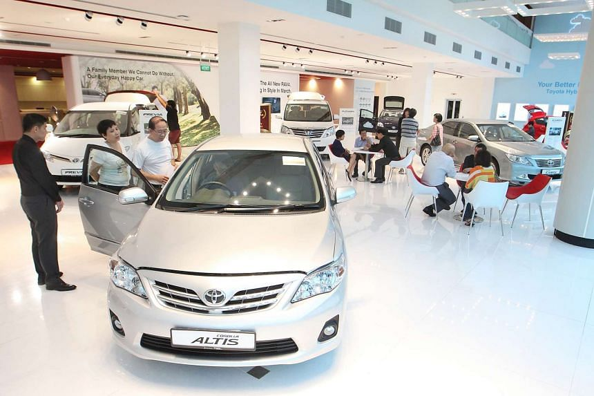 Potential car buyers seen inside the Toyata showroom, on March 16, 2013.