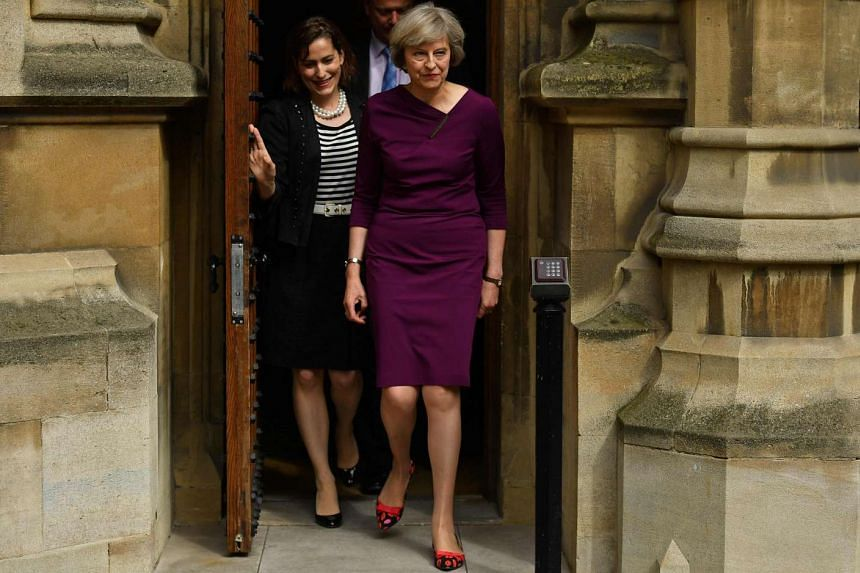 British Conservative party leadership candidate Theresa May (right) arriveing at the Palace of Westminster in London on July 7, 2016.