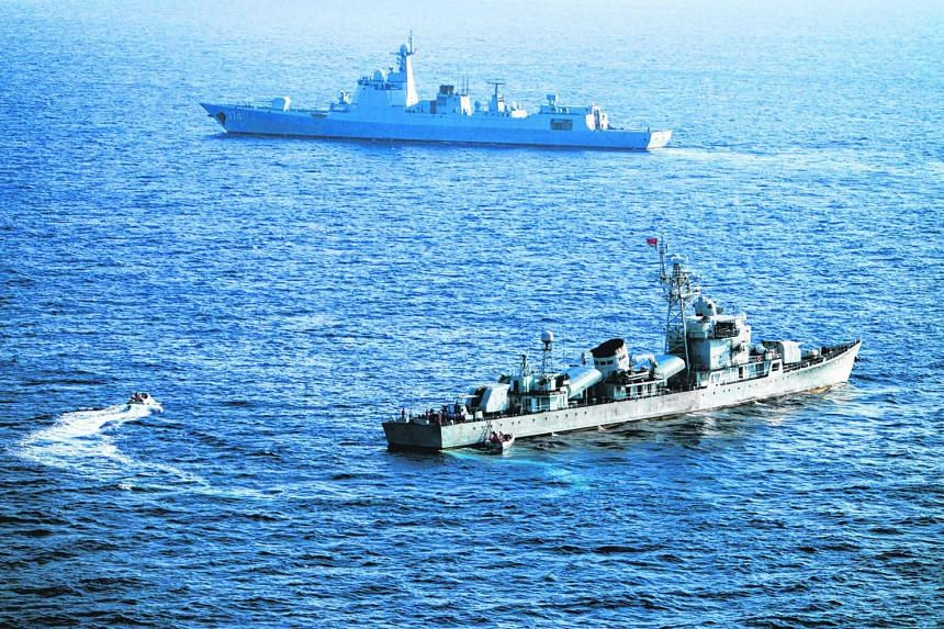 Crew members of China's South Sea Fleet taking part in a drill in the Xisha Islands, or the Paracel Islands in the South China Sea, on May 5, 2016.