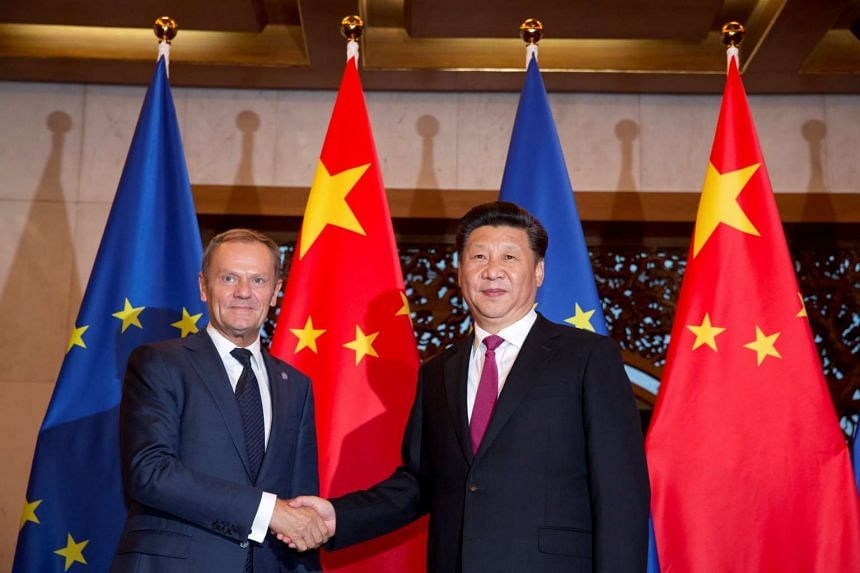 European Union President Donald Tusk (left) and Chinese President Xi Jinping shake hands before a meeting in Beijing, on July 12, 2016.