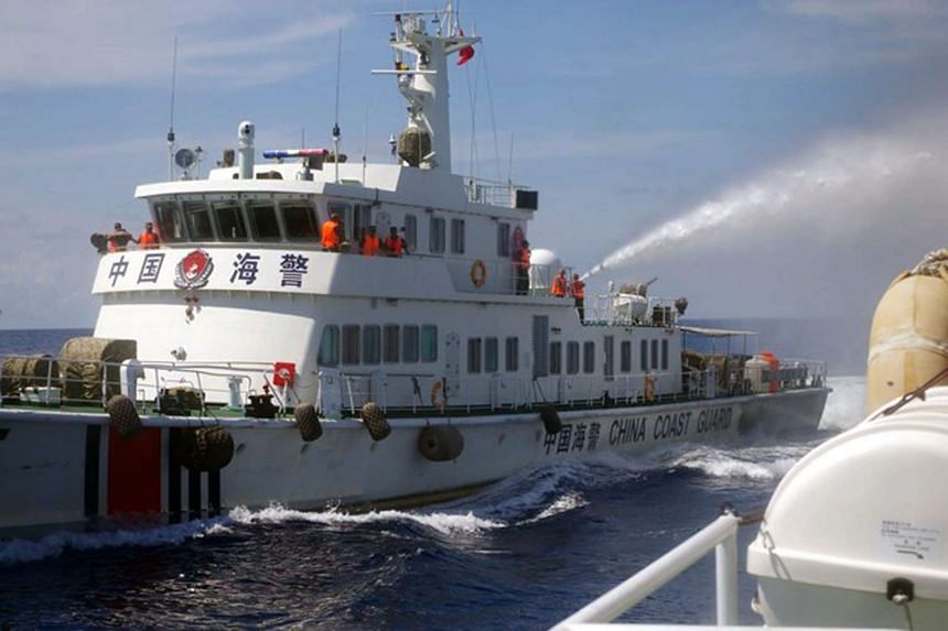 A Chinese coast guard vessel using water cannons on a Vietnamese vessel near the Paracel islands in 2014.
