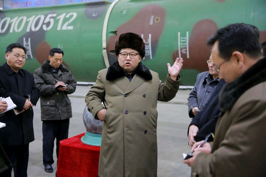 North Korean leader Kim Jong Un meets scientists and technicians in the field of research into nuclear weapons in this undated photo released by North Korea's Korean Central News Agency in Pyongyang on March 9.