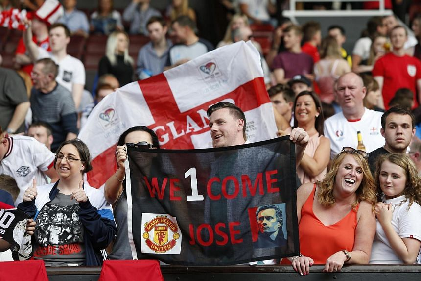 A Manchester United fan welcomes their new manager Jose Mourinho.