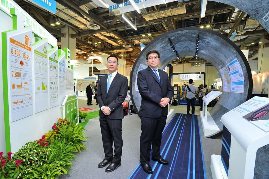 Mr Joseph Boey, (left) Project Director, IWMF, NEA and Mr Yong Wei Hin, (right) Director, DTSS Phase 2, PUB, at the 'Water-Energy-Waste Nexus: The Singapore Journey' showcase at the City Solutions Singapore Expo, on July 10 2016.