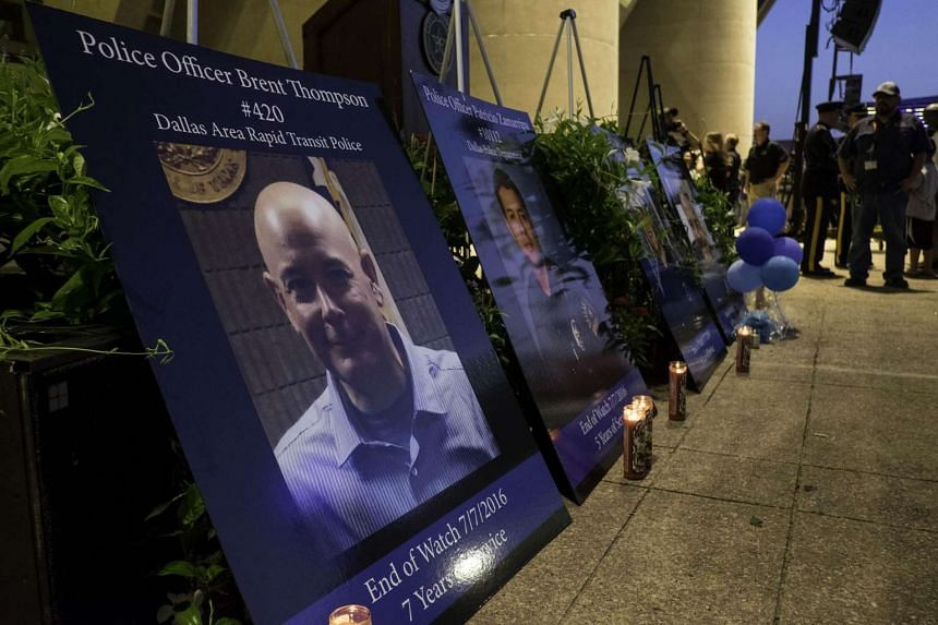Placards of the five police officers killed in the ambush on Thursday July 8 are on view at the Dallas Strong Candlelight Vigil on July 11 in Dallas, Texas.