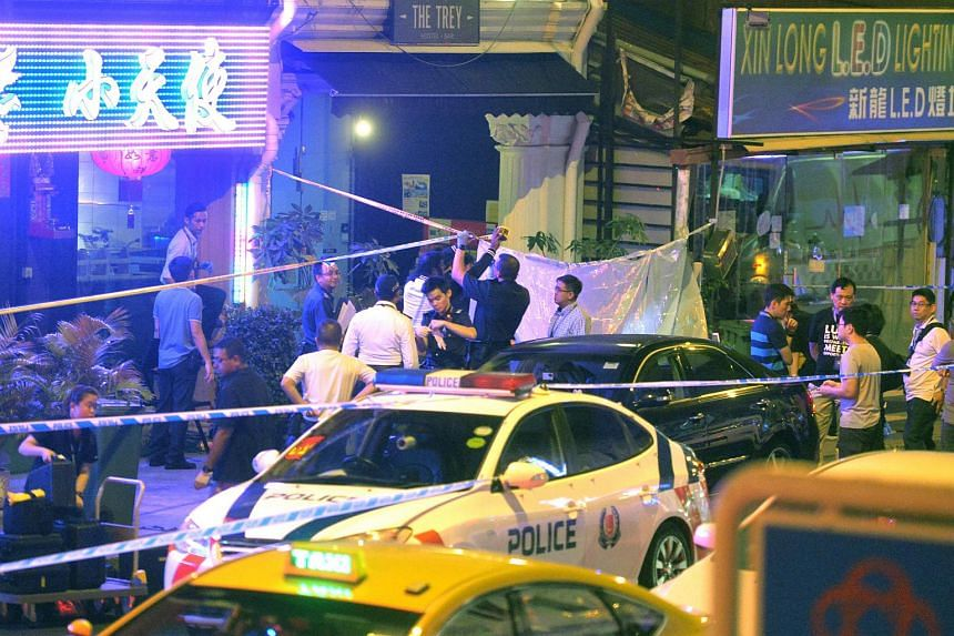 Policemen at the crime scene after a 42-year-old man's body was found. The victim was stabbed repeatedly outside a Jalan Besar pub on Monday night after an argument with another man.
