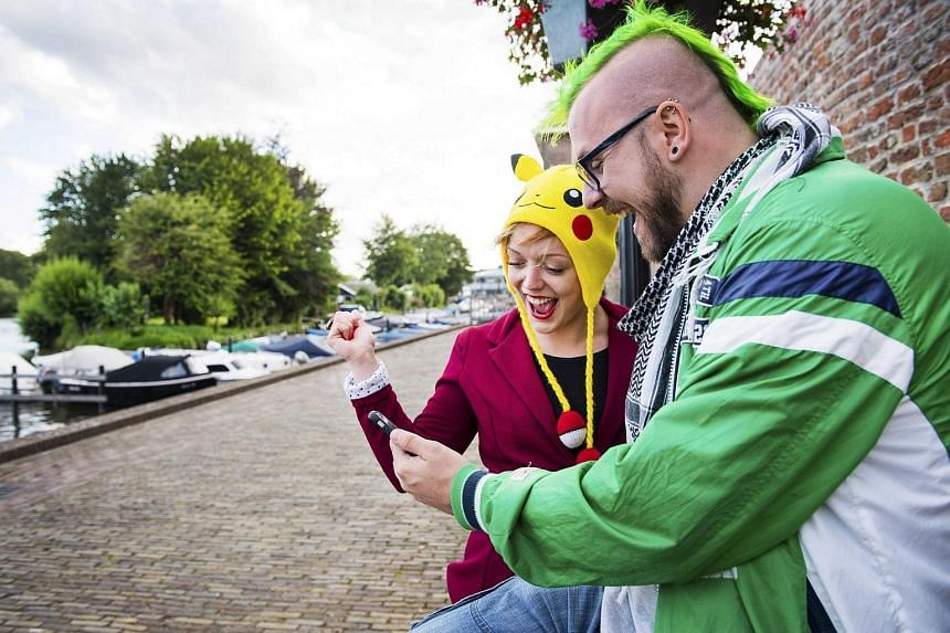 People play Pokemon Go on their smartphone in Leerdam, The Netherlands.