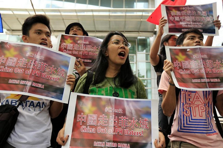 Filipino protestors stage a demonstration in front of the Chinese consular office in Makati, south of Manila, Philippines, July 11.
