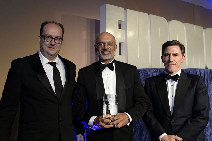 From left: Euromoney editor Clive Horwood, DBS chief executive Piyush Gupta, and emcee Rob Brydon at the finance magazine's Awards for Excellence event in London.