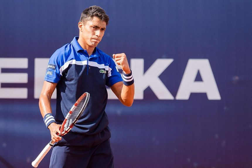 Thiago Monteiro from Brazil pumps his fist after winning a point against Mischa Zverev from Germany in their first round match for the German Tennis Championships at the Rothenbaum tennis stadium in Hamburg, Germany on July 11 2016.