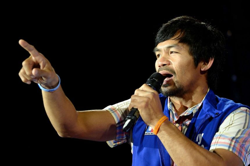 Manny Pacquiao speaks onstage during presidential candidate and Vice President Jejomar Binay's Miting De Avance in Manila.
