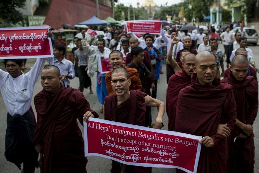 Buddhist monks take part in a rally near Shwedagon pagoda in Yangon on July 10, 2016 in a show of opposition to a recent government edict referring to Muslim communities in Myanmar's divided Rakhine State.