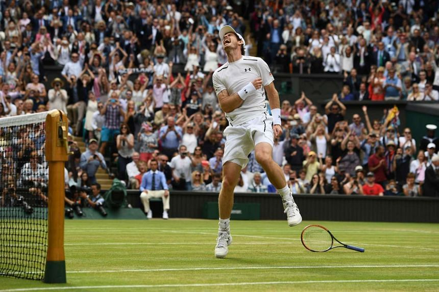 Andy Murray celebrates beating Milos Raonic after the men's singles final match on the last day of the 2016 Wimbledon Championships.