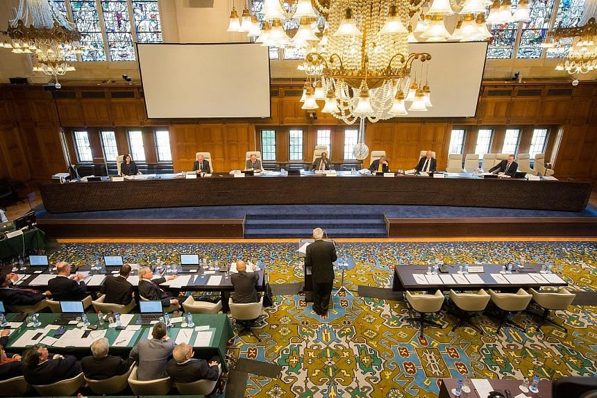 "A session during the jurisdictional hearing for the case that the Philippines brought against China at the Permanent Court of Arbitration in The Hague last July. Chinese Foreign Minister Wang Yi has called the case ""a political farce"" and said it ""ha"