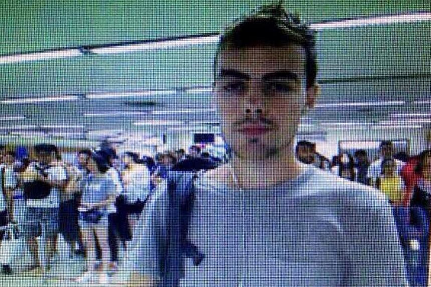 Roach, 26, in a picture taken at Bangkok airport, and released by Thai police yesterday.