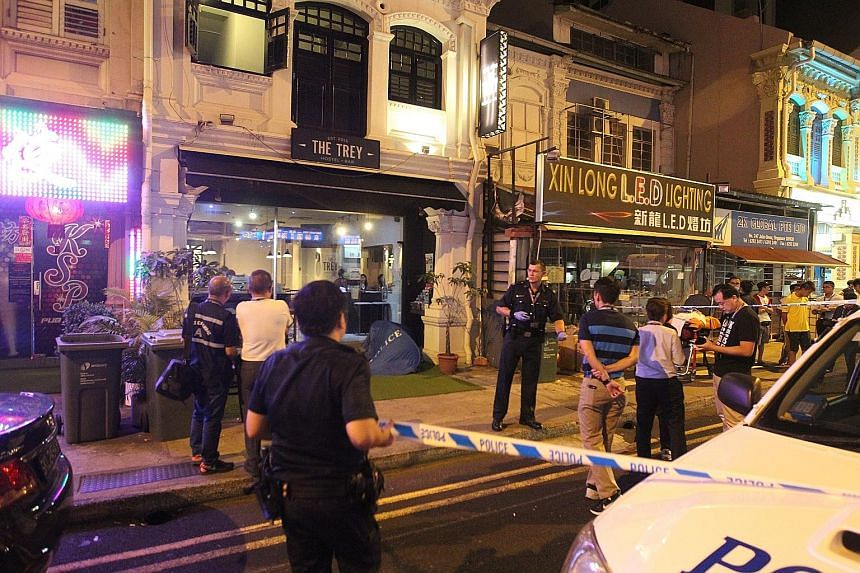 Witnesses said Mr Chua Meng Guan, 42, had challenged his assailant to a fight before a scuffle broke out outside the pub and the hostel next to it. Mr Chua was later pronounced dead at the hostel, The Trey.