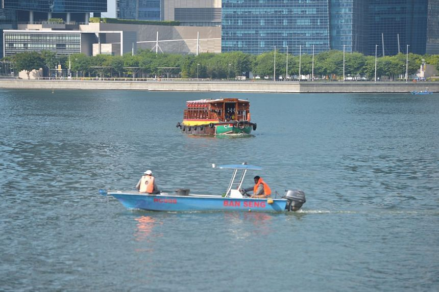 A PUB boat with a bumboat at the Marina Bay on July 13, 2016.