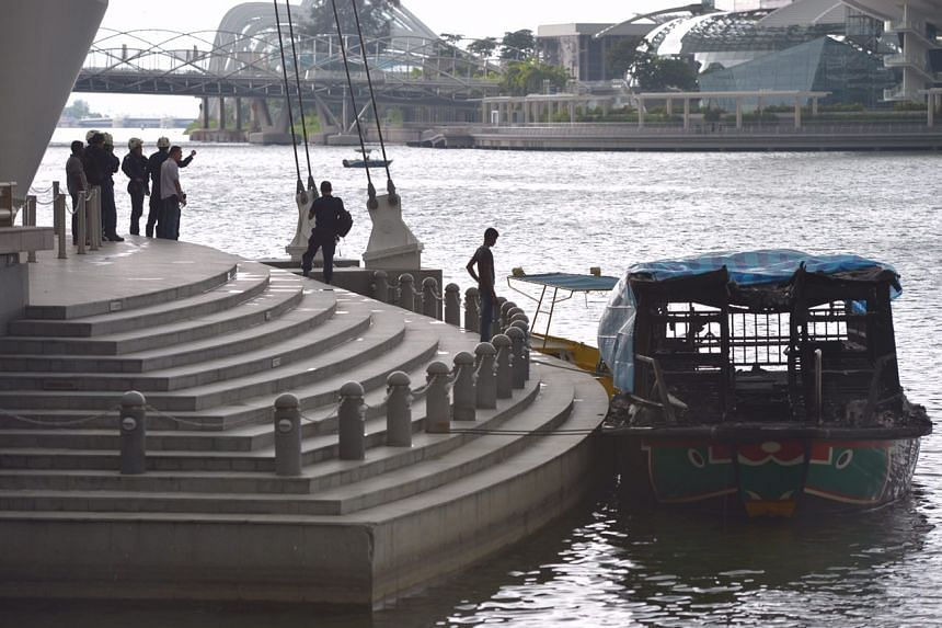 SCDF officers in a PUB boat in the search for the body on July 13, 2016.