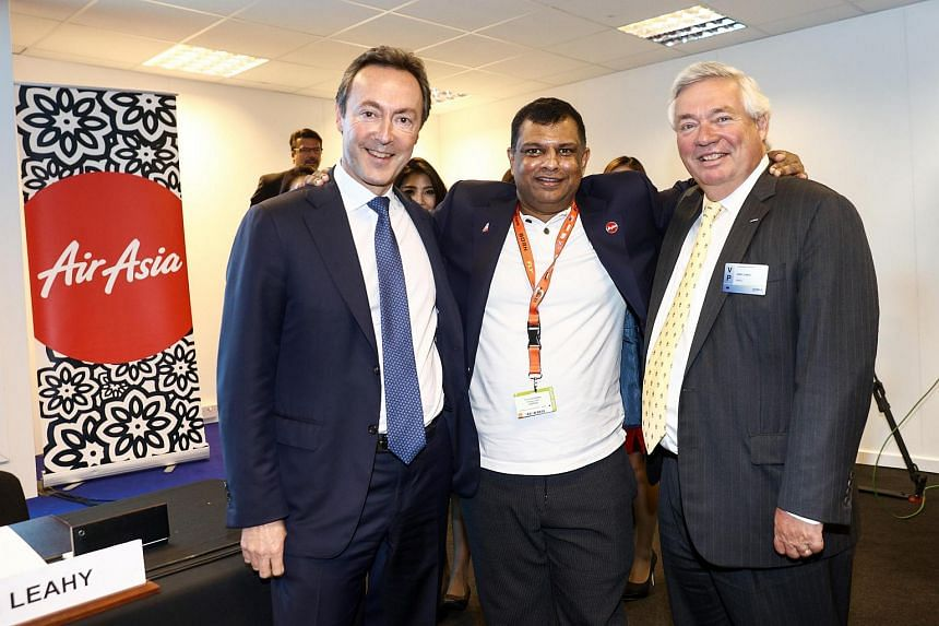 AirAsia group CEO Tony Fernandes (centre), with Airbus Group CEO Fabrice Bregier (left) and Airbus Group COO John Leahy.
