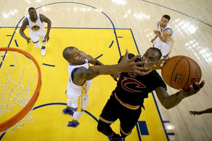 Andre Iguodala of the Golden State Warriors defends against LeBron James of the Cleveland Cavaliers in Game 7 of the 2016 NBA Finals at Oracle Arena on June 19, 2016 in Oakland, California.