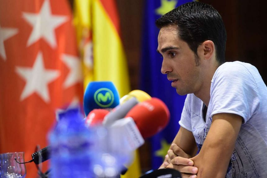 Tinkoff team's Spanish cyclist Alberto Contador looks on during a press conference at the CEMTRO hospital in Madrid on July 12, 2016.