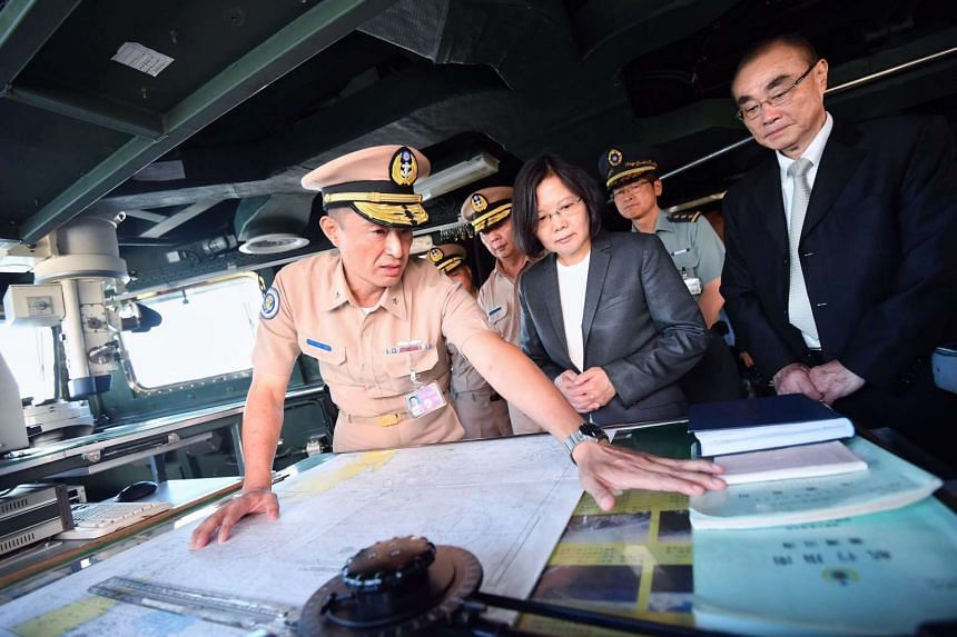 Taiwanese President Tsai Ing-wen (centre) on an inspection while aboard the Taiwanese Navy warship Kang Ding before it sets sail to Taiping Island in the South China Sea.