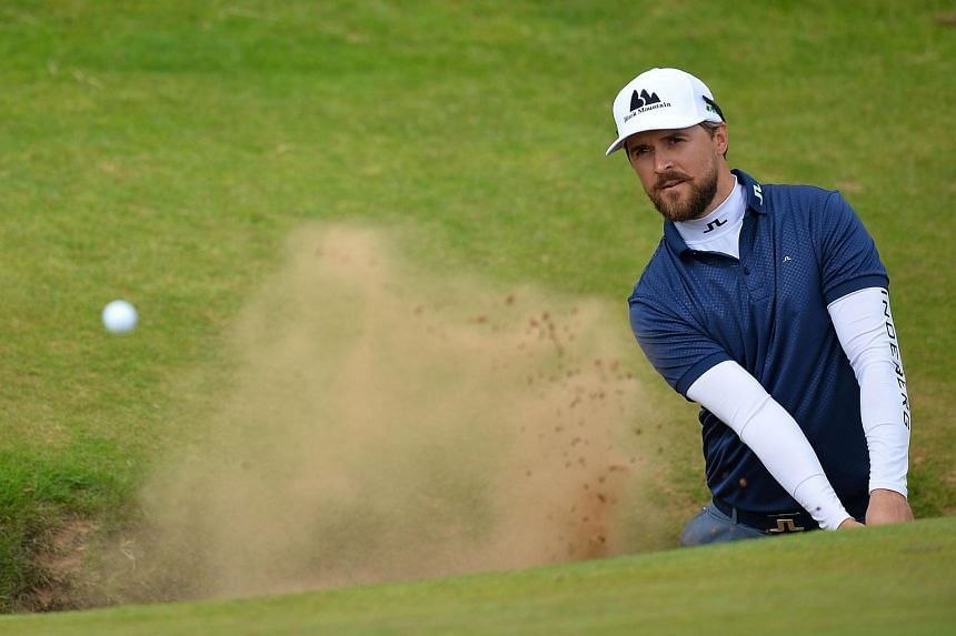 Sweden's Rikard Karlberg plays from a green-side bunker on the 8th hole during practice on July 12 ahead of the 2016 British Open Golf Championship.