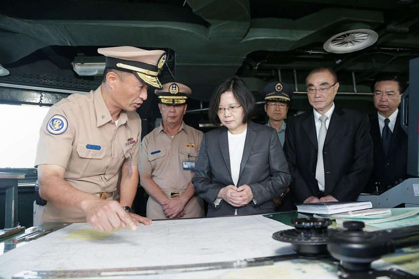 President Tsai Ing-wen (centre) meeting with officers on the deck of a Taiwanese warship before the vessel heads for Taiwan-controlled Taiping island in the Spratly island chain, at the base at Tsoying in the southern city of Kaohsiung.