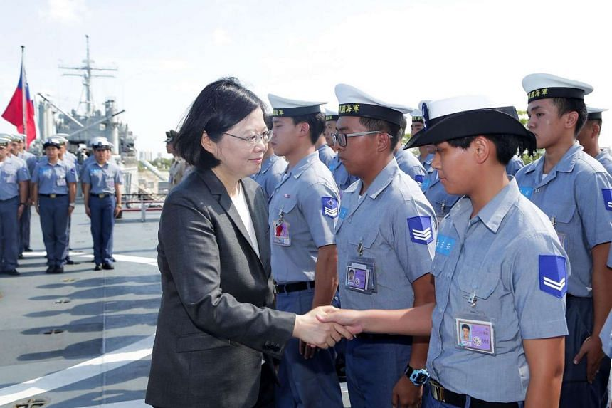 President Tsai Ing-wen meeting sailors on the deck of a Taiwanese warship before the vessel heads for Taiwan-controlled Taiping island in the Spratly island chain.