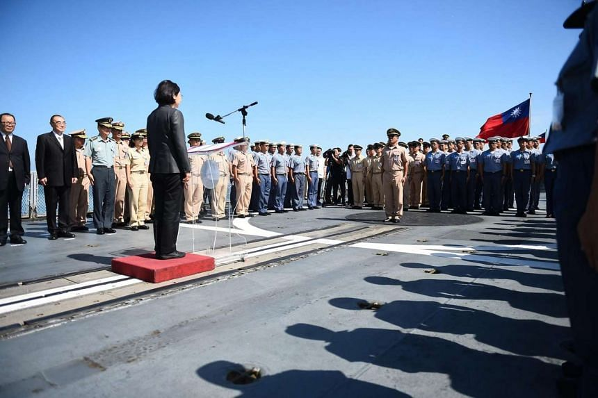Taiwanese President Tsai Ing-wen speaking to Taiwanese navy officers before they board the Taiwanese Navy warship Kang Ding before it sets sail to Taiping Island in the South China Sea at the Naval base in Kaohsiung, southern Taiwan on July 13, 2016.