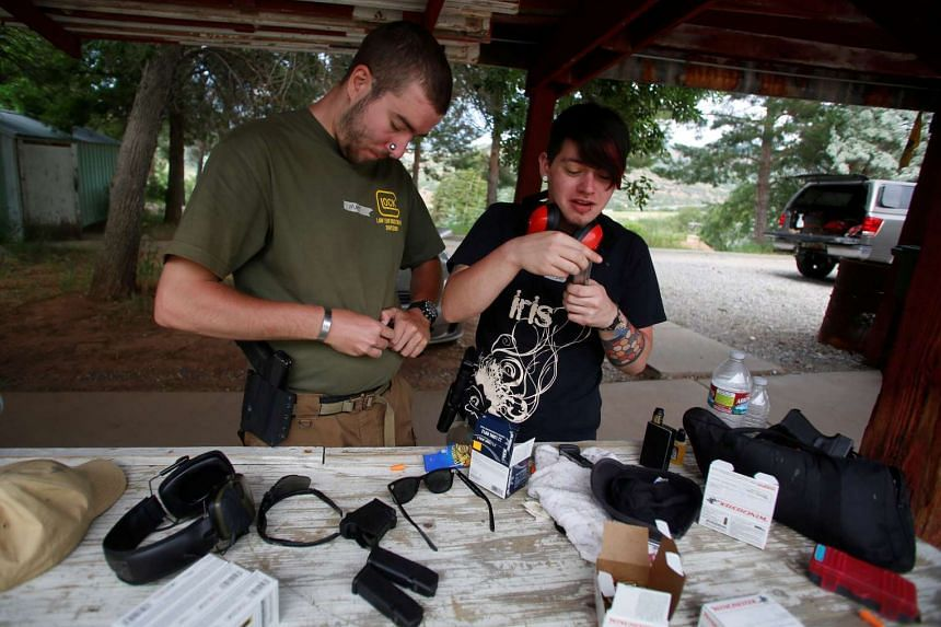 Salt Lake City Pink Pistols chapter president Matt Schlentz and his partner Skylar Simon load magazines of ammunition during a firearms training class attended by members of the Pink Pistols.